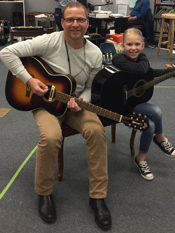 Guitarist Tommy Fedak teaches children